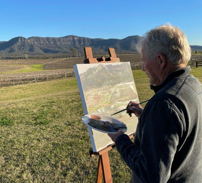Artist painting the Brokenback Ranges